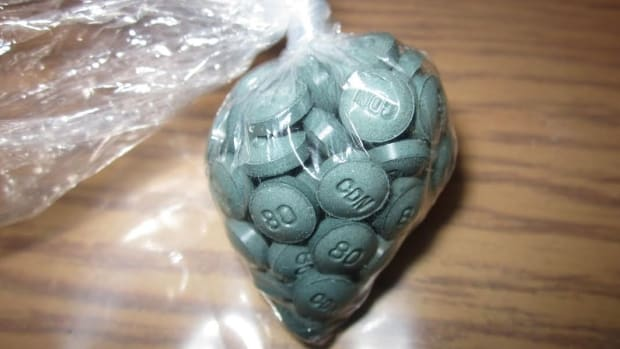 Plastic bag filled with w-18 opioid pills on a table